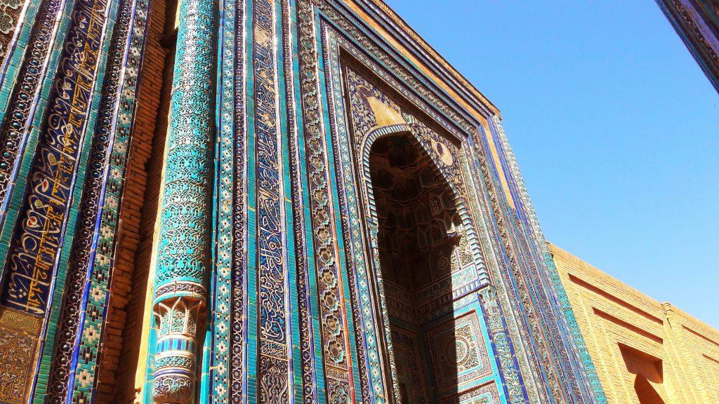 Info Shymkent - A mausoleum at Shah-i-Zinda with beautiful cyan and yellow oriental ornaments.