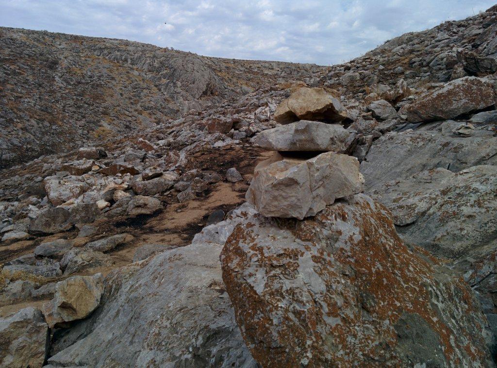 Info Shymkent - A rough limestone landscape around the cave.