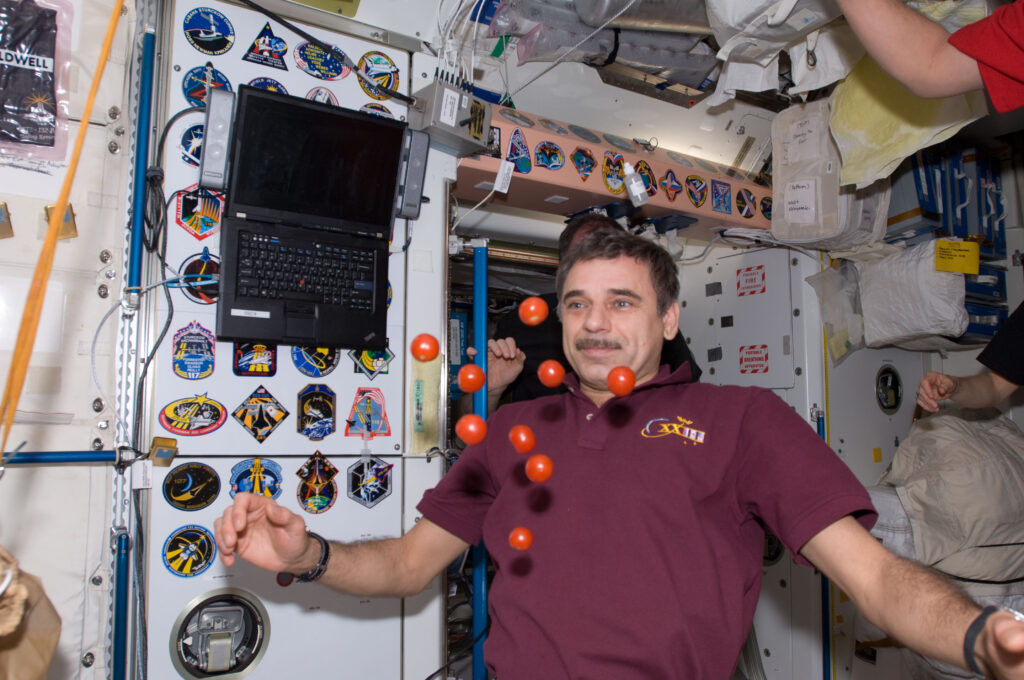 Info Shymkent - Cosmonaut Mikhail Kornienko playing with Tomatoes in Space (Image: NASA)