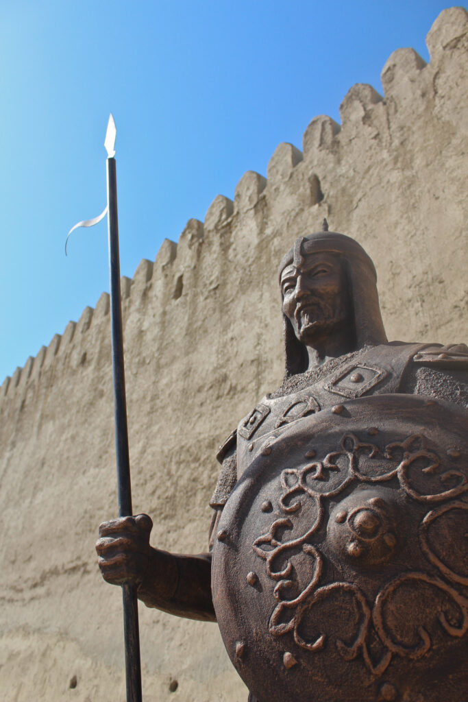 Info Shymkent - A warrior in front of the old city gate of Turkistan