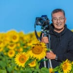 Info Shymkent - Photographer Farhat Kabdykairov from Kazakhstan in a sunflower field