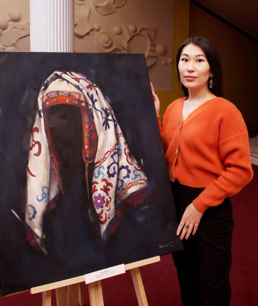 Info Shymkent - Kazakh Artist Alua Tebenova standing next to one of her painting