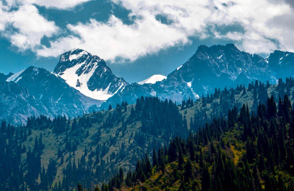 Info Shymkent - Snow capped mountains of Ile Alatau mountains in Kazakhstan by photographer Zhambay