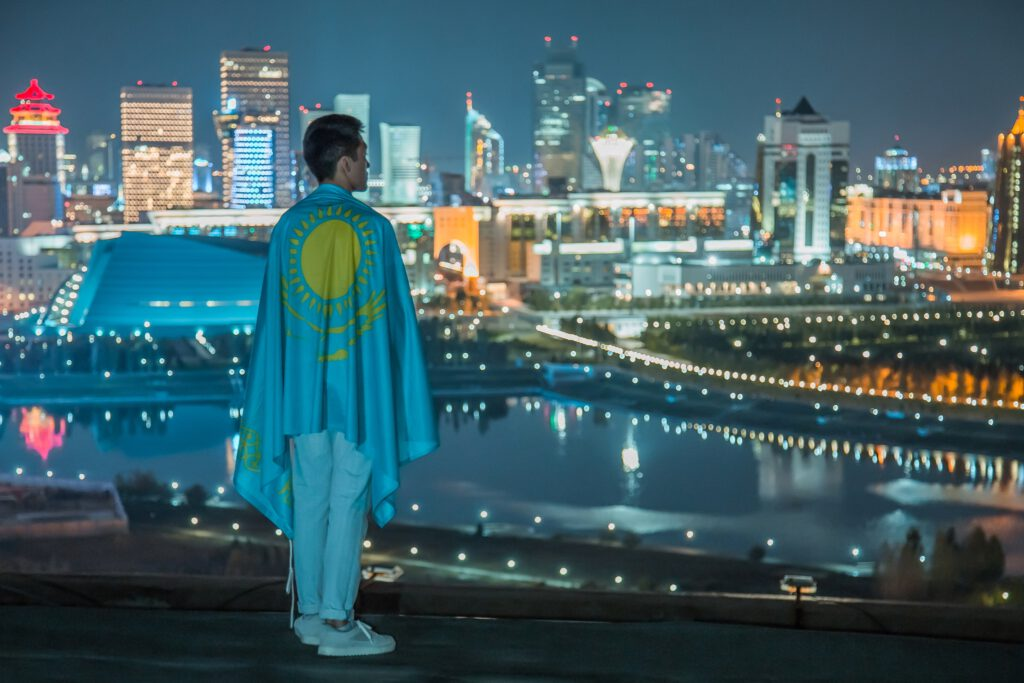 Info Shymkent - Portrait Photographer Zhambay took a picture of a patriot with flag in Nur-Sultan, Kazakhstan