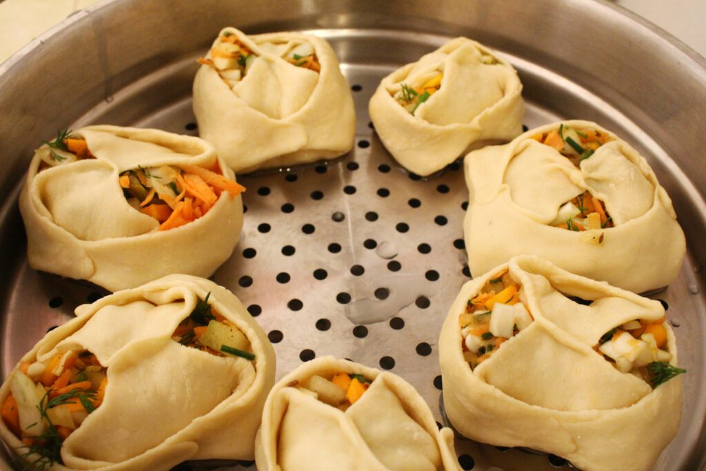 Preparing the dumplings to steam in the Manti cooker